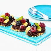 Waffle biscuits topped with chocolate cream and fruit