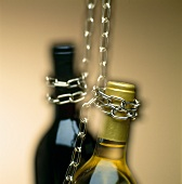 Bottle necks hanging on chains
