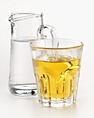 Whisky glass, carafe of water beside it