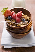 Muesli and berries in wooden bowl