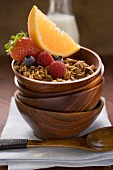 Muesli and fruit in wooden bowl