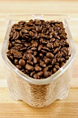 Roasted coffee beans in a glass scoop