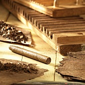 Cigar-making: cigars, tobacco leaves and tool