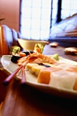 Assorted sushi on platter in sushi bar