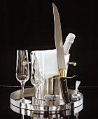 Champagne with glasses and champagne knife