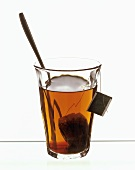 A glass of tea with tea bag