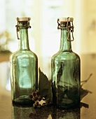 Green flip-top bottles and unripe blackberries