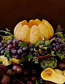 Autumn still life with pumpkin and grapes