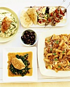 Chicken on spinach, risotto, lamb kebabs & pasta bolognese