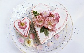 Two heart-shaped cakes with sugared roses