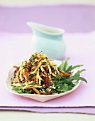 Rice salad with fried vegetables and rocket