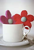 White coffee cup with felt flowers