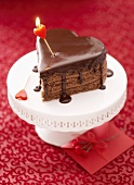 Heart-shaped chocolate cake with candle
