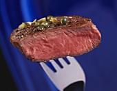Peppered steak on fork