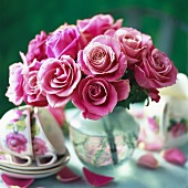 Pink roses and cups and saucers