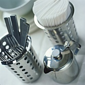 Stainless steel teapot, cutlery holder and napkin holder