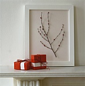 Gifts wrapped in red paper on mantelpiece