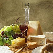 Still life with cheese, wine and grapes
