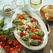 Potato and spinach gnocchi with cherry tomatoes