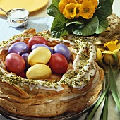 Easter wreath in choux pastry with coloured eggs