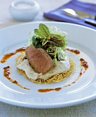 Grilled lamb fillet with baba ganoush on kataifi nest