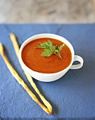 Tomato cream soup with cheese sticks