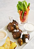 Glazed chicken thighs with potato wedges and dip