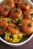 Tomatoes stuffed with bulgur wheat, pine nuts and raisins