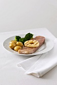 Grilled ham with pineapple, potatoes and broccoli