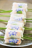 Spring rolls with borage flowers and shrimps
