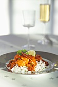 Lobster with white wine and tomatoes on rice