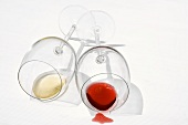Two wine glasses lying on their sides