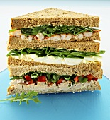 Three sandwiches in a pile