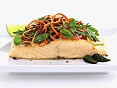 Fried salmon steak with vegetable topping