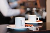Two cups of espresso at espresso bar
