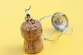 Champagne cork with racing cyclist
