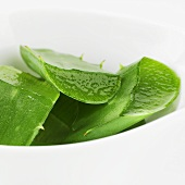 Pieces of Aloe vera leaves in a bowl