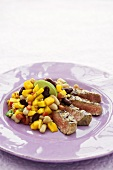 Grilled beef steak with mango and bean salsa