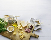 Ingredients for ravioli with pesto, salami & Parmesan