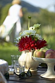 Dahlias in a china jug as table decoration