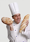 Chef with two loaves of bread