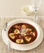 Tomato soup with tortellini and spinach