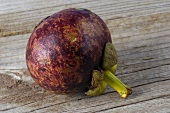 A whole mangosteen