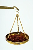 Saffron threads in a scale pan