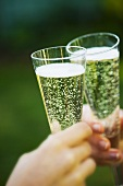 Clinking champagne flutes together