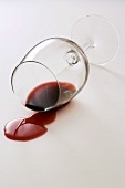 A glass of red wine on its side