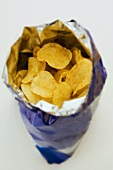 An open packet of potato crisps