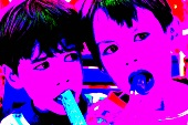 Two children licking ice creams