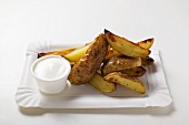 Baked potato wedges with sour cream