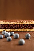 Eclair with chocolate cream filling and blueberries